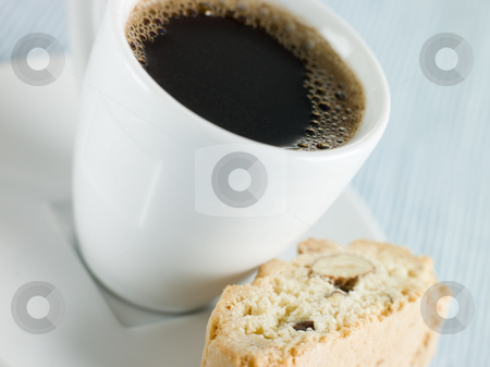 Cup of Espresso Coffee with Hazelnut Biscotti stock photo, Close up shot of Cup of Espresso Coffee with Hazelnut Biscotti by Monkey Business Images
