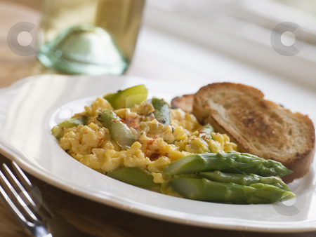 Scrambled Egg and Asparagus with Toasts stock photo,  by Monkey Business Images