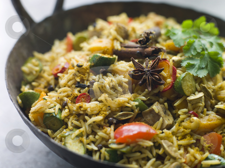 Vegetable Biryani in a Large Karahi stock photo, Vegetable Biryani in a Large Karahi pan by Monkey Business Images