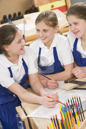 Schoolgirls in woodwork class stock photo,  by Monkey Business Images