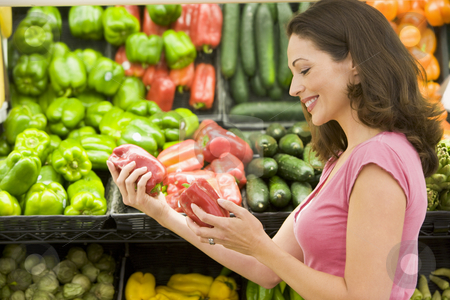 Woman shopping in produce section stock photo, Woman shopping in produce section by Monkey Business Images