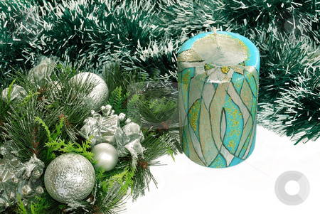 Blue candle over new year background stock photo, Decorative candle over green new year adorning by Julija Sapic
