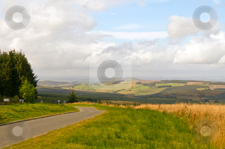 Hill scape stock photo, Road trough hill and mountain landscape with rural pastures on the side by Karin Claus