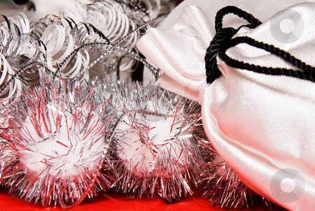Xmas decoration with gift bag  stock photo, Xmas decoration with gift bag on a red cloth by Karin Claus