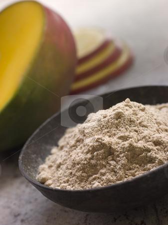 Dish of Mango Powder with sliced Fresh Mango stock photo, Dish of Mango Powder with sliced Fresh Mango on the side by Monkey Business Images