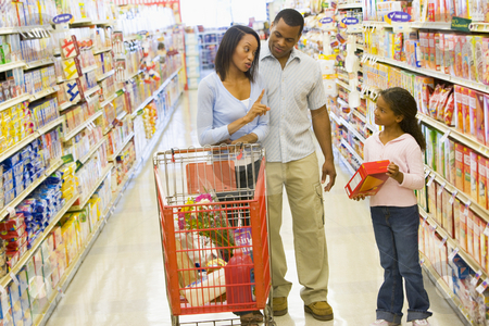 Family having disagreement in supermarket stock photo, Mother refusing to buy product for child in supermarket by Monkey Business Images
