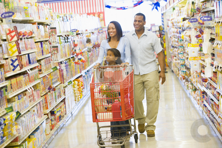 Family shopping in supermarket stock photo, Family shopping for groceries in supermarket by Monkey Business Images