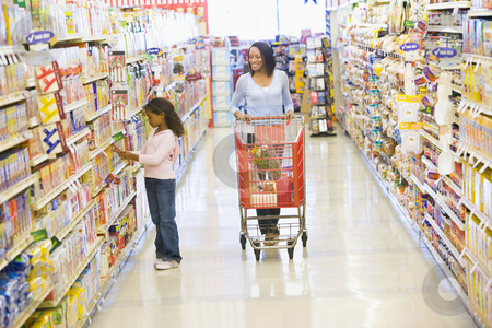 Mother and daughter shopping in supermarket stock photo, Mother and daughter shopping for groceries in supermarket by Monkey Business Images