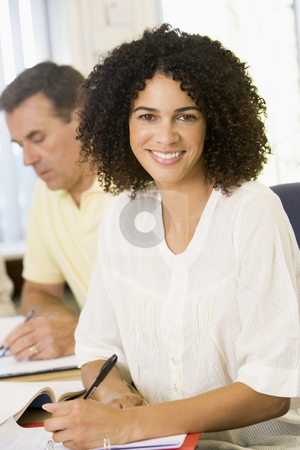 Mid adult woman studying with other adult students stock photo,  by Monkey Business Images