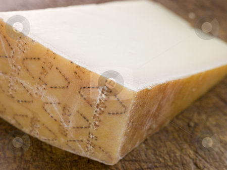 Wedge of Parmesan Cheese stock photo,  by Monkey Business Images