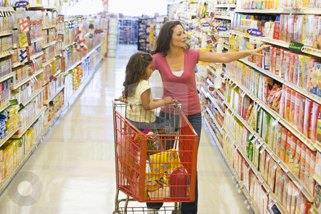 Mother and daughter shopping in supermarket stock photo, Mother and daughter grocery shopping in supermarket by Monkey Business Images