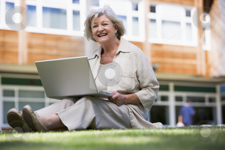 Senior woman using laptop on campus stock photo,  by Monkey Business Images