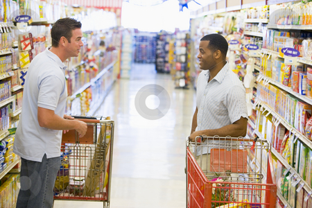 Two men meeting in supermarket stock photo, Two men meeting and talking in supermarket by Monkey Business Images