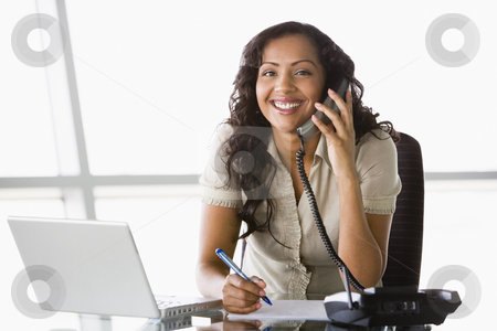 Businesswoman taking telephone call  stock photo, Businesswoman taking telephone call in office by Monkey Business Images