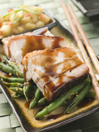 Roast Belly Pork with Fuji Apples and Peanut Beans stock photo, Plate of Roast Belly Pork with Fuji Apples and Peanut Beans and chopsticks by Monkey Business Images