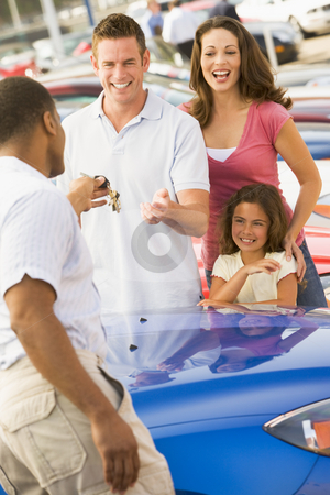 Family collecting new car stock photo, Family collecting new car from dealer by Monkey Business Images