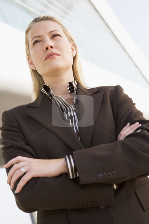 Businesswoman standing outdoors by building stock photo,  by Monkey Business Images