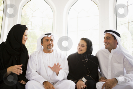 A Middle Eastern family sitting together stock photo,  by Monkey Business Images