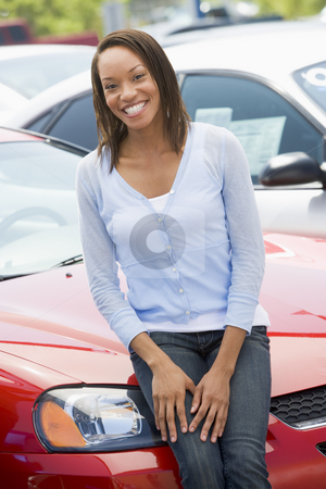 Woman choosing new car stock photo,  by Monkey Business Images