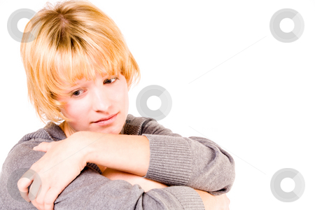Red haired girl looking depressed and pensive stock photo, Studio portrait of a red haired girl looking sad by Frenk and Danielle Kaufmann