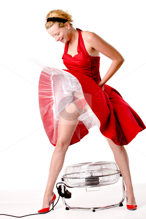 Funny girl in red gala dress standing over a ventilator stock photo, Girl in red gala dress making fun with a ventilator by Frenk and Danielle Kaufmann
