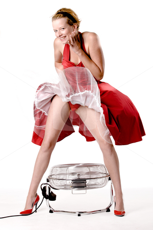 Funny girl in red gala dress being playful with a ventilator stock photo, Girl in red gala dress making fun with a ventilator by Frenk and Danielle Kaufmann