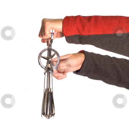 Beater stock photo, An oldfashioned egg beater, being held by someone by Richard Nelson