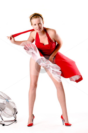 Funny girl in red gala dress playing sexy with a ventilator stock photo, Girl in red gala dress making fun with a ventilator by Frenk and Danielle Kaufmann