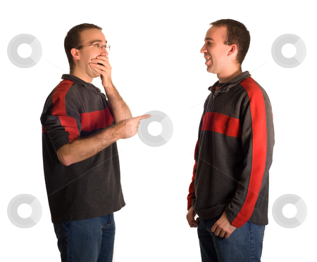 Pointing And Laughing stock photo, A man pointing and laughing at his identical twin, isolated against a white background by Richard Nelson