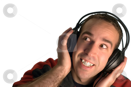 Man Listening to Music stock photo, A young man listening to music on a set of headphones, isolated against a white background by Richard Nelson