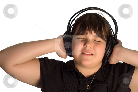 Leisure Activity stock photo, A young girl listening to some music on a large set of headphones by Richard Nelson
