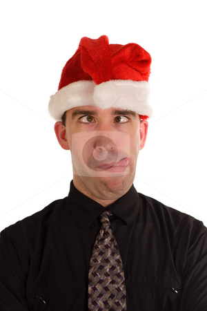 Silly Christmas Employee stock photo, An employee making a funny face while wearing a Christmas hat by Richard Nelson