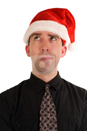 Puzzled Christmas Employee stock photo, A puzzled looking employee wearing a santa cap by Richard Nelson