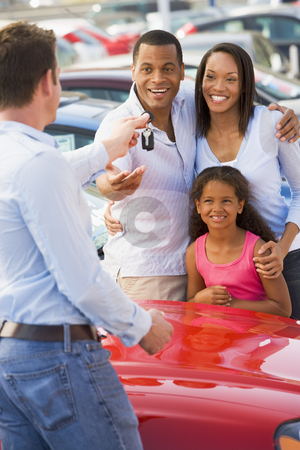 Young family picking up new car  stock photo, Family picking up new car from saleman by Monkey Business Images