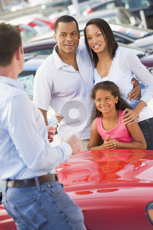 Young family collecting new car stock photo, Young family collecting new car from salesman by Monkey Business Images