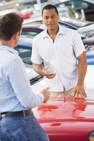 Man talking to car salesman stock photo, Man talking to car salesman at lot by Monkey Business Images