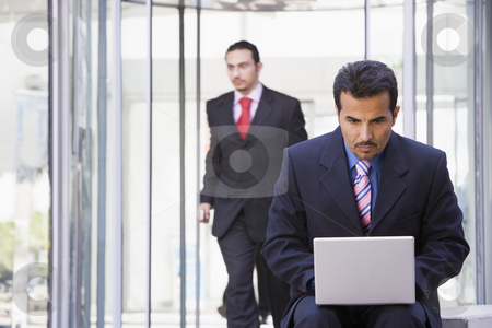 Businessman using laptop outside stock photo, Businessman using laptop outsidde office by Monkey Business Images