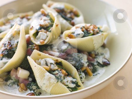 Conchiglioni pasta shells with Spinach Pancetta Pine Nuts and Go stock photo,  by Monkey Business Images