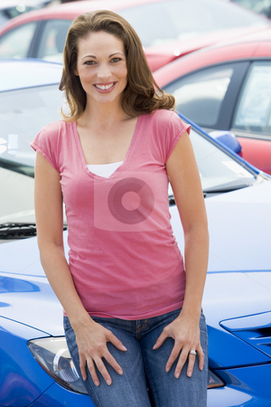 Woman choosing new car stock photo, Woman choosing new car from lot by Monkey Business Images