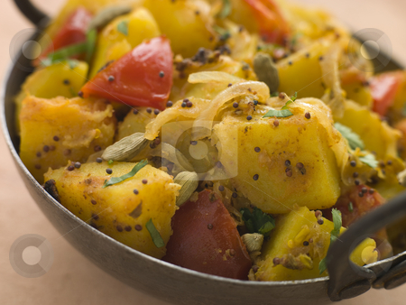 Bombay Aloo - Curried Potatoes stock photo, Pan of Bombay Aloo - Curried Potatoes by Monkey Business Images