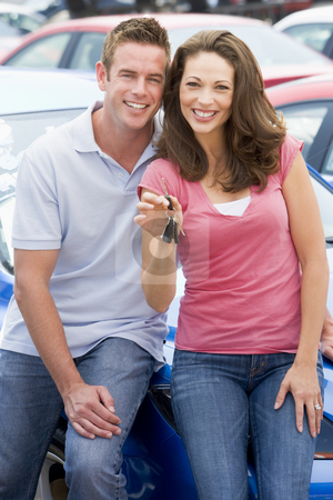 Young couple collecting new car stock photo, Young couple collecting new car from lot by Monkey Business Images
