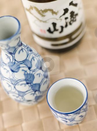 Sake Bottle Jug and Cup  stock photo, Sake Bottle Jug and Cup with bottle of sake by Monkey Business Images