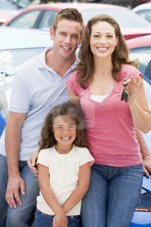 Young family collecting new car stock photo, Young family collecting new car from lot by Monkey Business Images