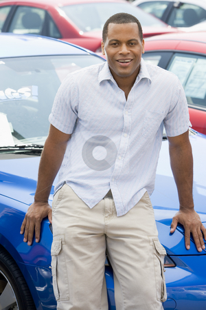 Man picking up new car stock photo, Man picking up new car from lot by Monkey Business Images