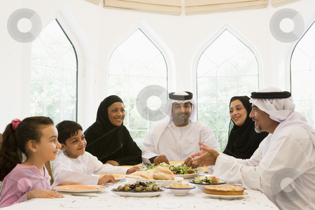 A Middle Eastern family enjoying  stock photo,  by Monkey Business Images