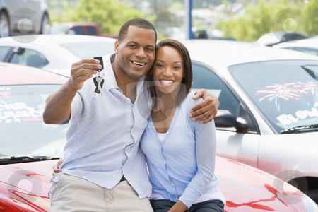 Couple picking up new car stock photo, Couple picking up new car from lot by Monkey Business Images