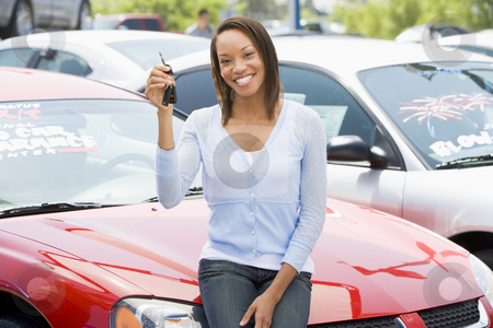 Woman picking new car stock photo, Woman picking up new car from lot by Monkey Business Images