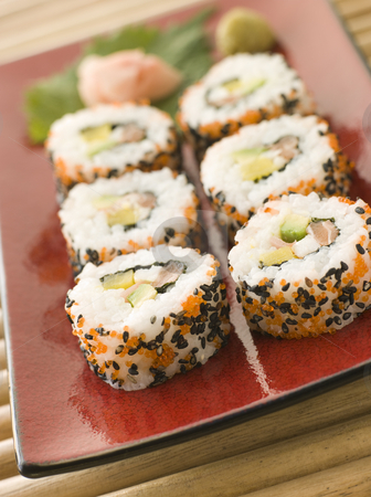 Inside-out Sushi Rolls stock photo, Plate of Inside-out Sushi Rolls decorated with roe and sesame seeds by Monkey Business Images