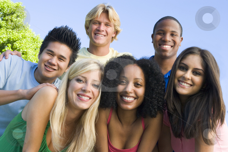 Group of friends outside stock photo, Group of six young friends having fun outside by Monkey Business Images