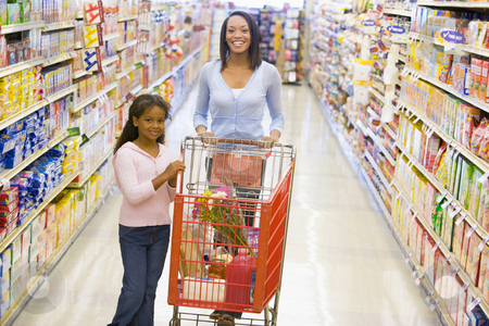 Mother and daughter grocery shopping stock photo, Mother and daughter grocery shopping in supermarket by Monkey Business Images